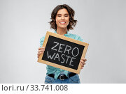 Купить «happy woman with chalkboard with zero waste words», фото № 33741008, снято 18 апреля 2020 г. (c) Syda Productions / Фотобанк Лори