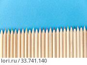 Купить «coloring pencils on blue background», фото № 33741140, снято 10 сентября 2019 г. (c) Syda Productions / Фотобанк Лори