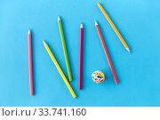 Купить «coloring pencils and rubber bands on blue», фото № 33741160, снято 10 сентября 2019 г. (c) Syda Productions / Фотобанк Лори