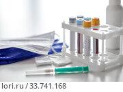 beakers with coronavirus blood tests and syringe. Стоковое фото, фотограф Syda Productions / Фотобанк Лори