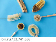different cleaning brushes on blue background. Стоковое фото, фотограф Syda Productions / Фотобанк Лори