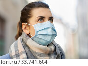 Купить «young woman wearing protective medical mask», фото № 33741604, снято 8 апреля 2020 г. (c) Syda Productions / Фотобанк Лори