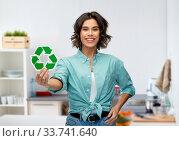 Купить «smiling young woman holding green recycling sign», фото № 33741640, снято 18 апреля 2020 г. (c) Syda Productions / Фотобанк Лори
