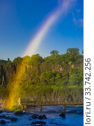 Купить «Rainbow, Iguazu Falls (Iguacu in Portugese), on the border of Brazil and Argentina. It is one of the New 7 Wonders of Nature and is a UNESCO World Heritage...», фото № 33742256, снято 28 февраля 2020 г. (c) age Fotostock / Фотобанк Лори
