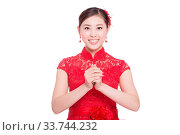 Купить «Young chinese woman in red cheongsam with greeting gesture in chinese new year on white background», фото № 33744232, снято 14 июля 2020 г. (c) age Fotostock / Фотобанк Лори
