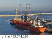 Купить «Docked Trans Adriatic cargo ship and four-link cargo loading cranes on dock in Ashdod Port, Israel.», фото № 33744280, снято 4 октября 2019 г. (c) age Fotostock / Фотобанк Лори
