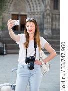 Купить «Emotional female tourist making selfie», фото № 33747960, снято 17 мая 2017 г. (c) Яков Филимонов / Фотобанк Лори