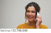 Купить «happy young woman calling on smartphone», видеоролик № 33748640, снято 27 марта 2020 г. (c) Syda Productions / Фотобанк Лори