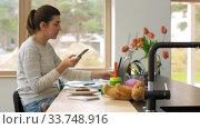 Купить «young woman with smartphone working at home office», видеоролик № 33748916, снято 11 апреля 2020 г. (c) Syda Productions / Фотобанк Лори