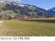 Купить «Узкоколейная железная дорога в горной долине. Солнечный день в начале марта. Долина Циллерталь, Тироль, Австрия.», фото № 33748960, снято 8 марта 2020 г. (c) Сергей Рыбин / Фотобанк Лори