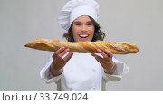 Купить «happy female chef with french bread or baguette», видеоролик № 33749024, снято 9 апреля 2020 г. (c) Syda Productions / Фотобанк Лори