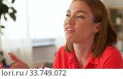 Купить «angry woman calling on smartphone at home office», видеоролик № 33749072, снято 11 апреля 2020 г. (c) Syda Productions / Фотобанк Лори