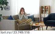 sick woman blowing nose in paper tissue at home. Стоковое видео, видеограф Syda Productions / Фотобанк Лори