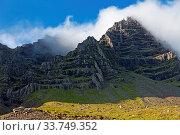 Купить «Wolken vor blauem Himmel am Berg Mosfell, Ostisland, Island, Europa», фото № 33749352, снято 28 мая 2020 г. (c) age Fotostock / Фотобанк Лори