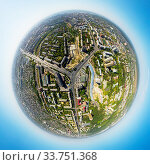 Купить «Aerial city view with crossroads and roads, houses, buildings, parks and parking lots, bridges. Copter shot. Little planet sphere mode.», фото № 33751368, снято 13 июля 2020 г. (c) age Fotostock / Фотобанк Лори