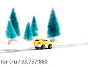 Купить «Small yellow car on paper road against fir-trees on wite background. Traffic on country road. Traffic on country road.», фото № 33757860, снято 13 мая 2020 г. (c) Papoyan Irina / Фотобанк Лори