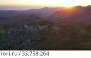 Купить «Unique landscape of Picos de Europa with rocky mountain ranges in thick clouds during sundown, Spain», видеоролик № 33758264, снято 15 июля 2019 г. (c) Яков Филимонов / Фотобанк Лори