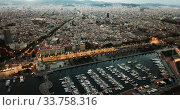 View from drones of sailboats and yachts in old port of Barcelona and gothic quarter at night (2018 год). Стоковое видео, видеограф Яков Филимонов / Фотобанк Лори