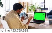 Купить «sick man with medicine having video call on laptop», видеоролик № 33759588, снято 22 мая 2020 г. (c) Syda Productions / Фотобанк Лори