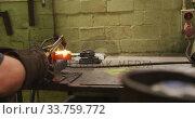 Купить «Caucasian male factory worker at a factory standing in a workbench and welding», видеоролик № 33759772, снято 23 ноября 2019 г. (c) Wavebreak Media / Фотобанк Лори
