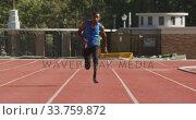 Купить «Disabled mixed race man with prosthetic legs running on race track», видеоролик № 33759872, снято 17 марта 2020 г. (c) Wavebreak Media / Фотобанк Лори
