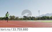 Купить «Disabled mixed race man with prosthetic legs running on race track », видеоролик № 33759880, снято 17 марта 2020 г. (c) Wavebreak Media / Фотобанк Лори