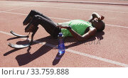 Купить «Disabled mixed race man with prosthetic legs lying on race track», видеоролик № 33759888, снято 17 марта 2020 г. (c) Wavebreak Media / Фотобанк Лори