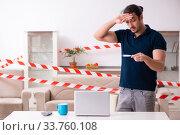 Купить «Young man feeling bored at home in self-isolation concept», фото № 33760108, снято 1 апреля 2020 г. (c) Elnur / Фотобанк Лори