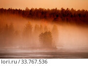 Купить «Spring late evening on a lake with fog, remains of ice and disturbing clouds. Foggy lake surrounded by forests», фото № 33767536, снято 28 мая 2020 г. (c) easy Fotostock / Фотобанк Лори