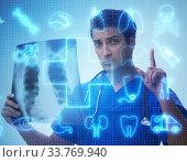 Купить «Doctor looking at x-ray image in telehealth concept», фото № 33769940, снято 4 июня 2020 г. (c) Elnur / Фотобанк Лори