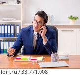Купить «Young handsome employee planning his work activity», фото № 33771008, снято 1 августа 2018 г. (c) Elnur / Фотобанк Лори