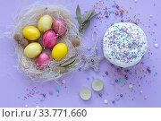 Купить «beautiful beautiful Easter composition in purple tones with painted eggs and cake», фото № 33771660, снято 12 апреля 2020 г. (c) Иванов Алексей / Фотобанк Лори