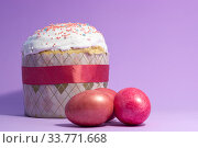 Купить «Easter cake decorated with pink decor and rose-colored eggs on a purple background», фото № 33771668, снято 12 апреля 2020 г. (c) Иванов Алексей / Фотобанк Лори