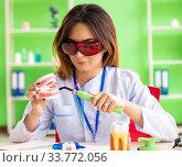 Купить «Woman dentist working on teeth implant», фото № 33772056, снято 11 июня 2018 г. (c) Elnur / Фотобанк Лори