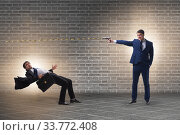 Купить «Businessman with gun threatening his competitor», фото № 33772408, снято 27 мая 2020 г. (c) Elnur / Фотобанк Лори