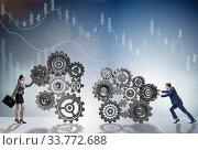 Купить «Teamwork concept with businessman and businesswoman», фото № 33772688, снято 28 мая 2020 г. (c) Elnur / Фотобанк Лори