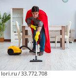Купить «Super hero cleaner working at home», фото № 33772708, снято 22 декабря 2016 г. (c) Elnur / Фотобанк Лори