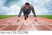 Businessman taking low start to running. Стоковое фото, фотограф Elnur / Фотобанк Лори