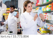 Woman pharmacist working in pharmacy. Стоковое фото, фотограф Яков Филимонов / Фотобанк Лори