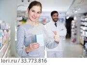 Купить «woman is satisfied of purchases in drugstore», фото № 33773816, снято 28 февраля 2018 г. (c) Яков Филимонов / Фотобанк Лори