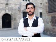 Купить «Serious man with arms crossed», фото № 33773832, снято 5 августа 2017 г. (c) Яков Филимонов / Фотобанк Лори