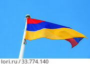 Купить «National flag of Armenia waving in the wind against the sky», фото № 33774140, снято 7 сентября 2019 г. (c) FotograFF / Фотобанк Лори