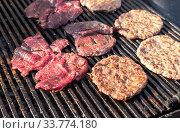 Купить «Appetizing pieces of grilled meat cooked on the grill», фото № 33774180, снято 5 октября 2019 г. (c) FotograFF / Фотобанк Лори