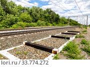 Купить «Double track electrified railway line», фото № 33774272, снято 6 июля 2019 г. (c) FotograFF / Фотобанк Лори