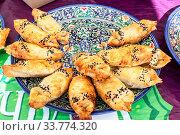 Купить «Traditional Uzbek pies in a large dish», фото № 33774320, снято 8 сентября 2019 г. (c) FotograFF / Фотобанк Лори