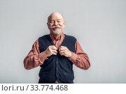 Купить «Smiling elderly man with mustache puts on a jacket», фото № 33774468, снято 7 февраля 2020 г. (c) Tryapitsyn Sergiy / Фотобанк Лори