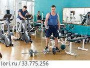 Portrait of man lifting dumbbells at gym. Стоковое фото, фотограф Яков Филимонов / Фотобанк Лори