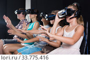 Купить «Happy daughter is fascinated of VR with family», фото № 33775416, снято 3 августа 2017 г. (c) Яков Филимонов / Фотобанк Лори