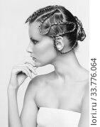 Купить «Black and white portrait in high key tone female with creative hairdo braids», фото № 33776064, снято 30 января 2012 г. (c) Serg Zastavkin / Фотобанк Лори