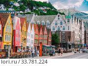 Купить «Bergen, Norway. View of historical buildings in Bryggen. Hanseatic wharf in Bergen, Norway July 28, 2019. UNESCO. Famous Bryggen street with wooden colored houses in Bergen Akerbrygge distric.», фото № 33781224, снято 28 июля 2019 г. (c) easy Fotostock / Фотобанк Лори
